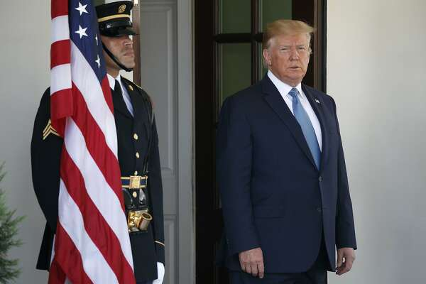 President Donald Trump waits to greet Pakistan's Prime Minister Imran Khan as he arrives at the White House, Monday, July 22, 2019, in Washington. (AP Photo/Jacquelyn Martin)