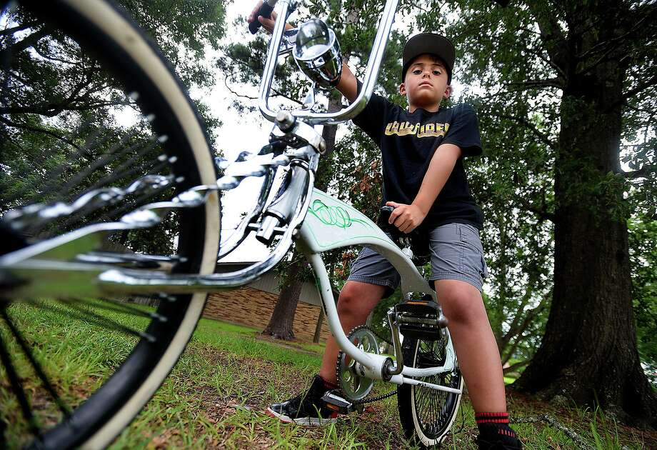 Eight-year-old Vladimir Pitman has plans to soup up the low rider bicycle that he got back earlier this month after it had been stolen and was missing for nearly 2 weeks. It is the second time Vladimir's bike has been stolen.   Photo taken Wednesday, June 26, 2019  Kim Brent/The Enterprise Photo: Kim Brent / The Enterprise / BEN
