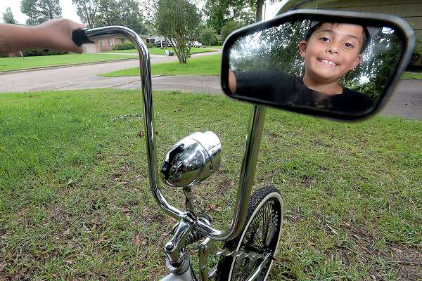 Eight-year-old Vladimir Pitman has plans to soup up the low rider bicycle that he got back earlier this month after it had been stolen and was missing for nearly 2 weeks. It is the second time Vladimir's bike has been stolen. Photo taken Wednesday, June 26, 2019 Kim Brent/The Enterprise