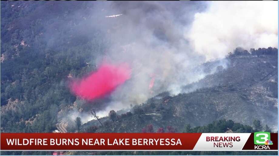 A grass fire burns near Lake Berryessa on July 22, 2019. Photo: KCRA