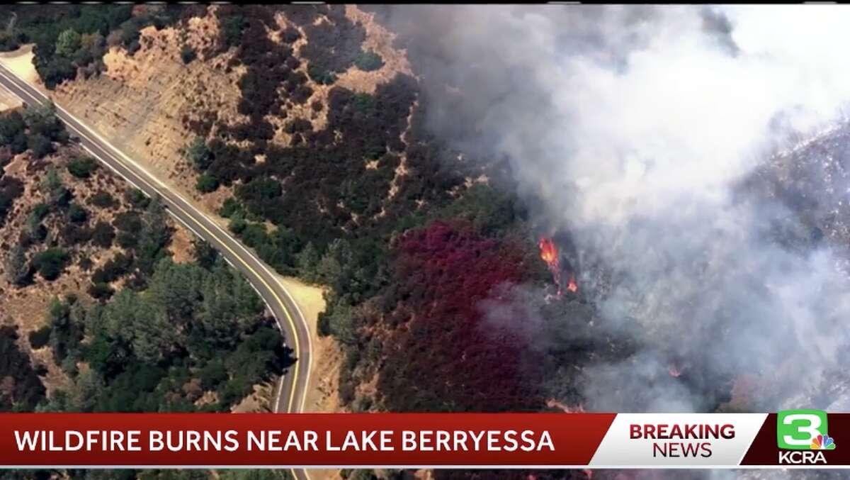 A grass fire burns near Lake Berryessa on July 22, 2019.