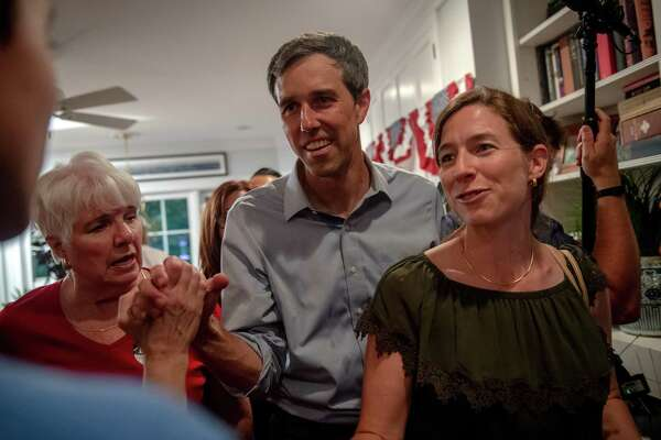 Beto O'Rourke, a Democratic candidate for president, is joined by his wife, Amy, right, as he speaks to a supporter at a campaign event in a private home in Ames, Iowa, on Tuesday, July 2, 2019. (Hilary Swift/The New York Times)