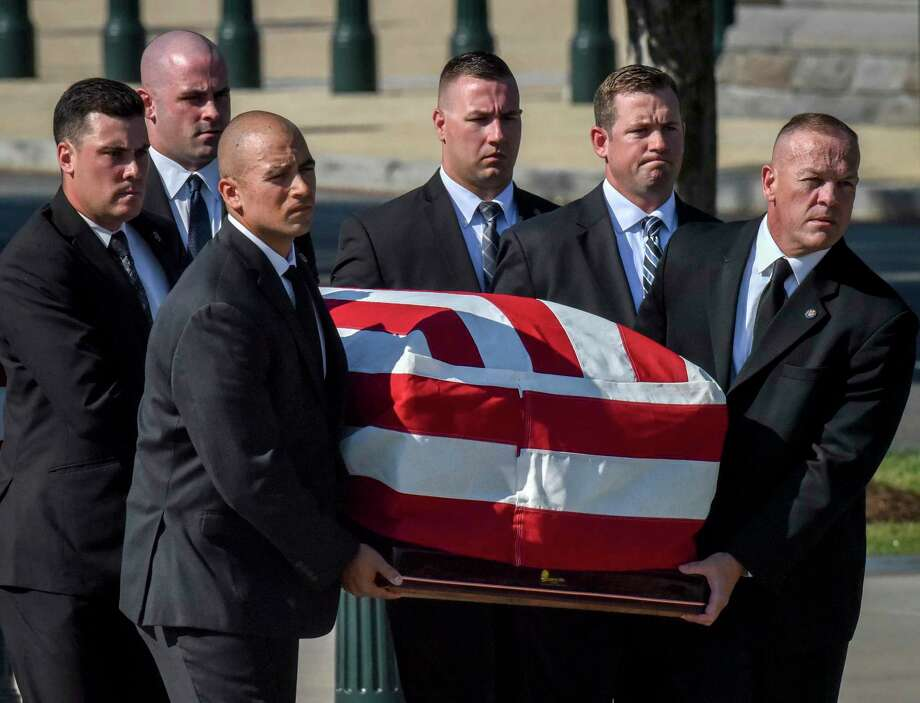 Supreme Court police officers serve as pallbearers as they transport the casket of retired Associate Justice John Paul Stevens into the Supreme Court to lie in repose on July 22, 2019, in Washington, D.C. Photo: Washington Post Photo By Bill O'Leary / The Washington Post