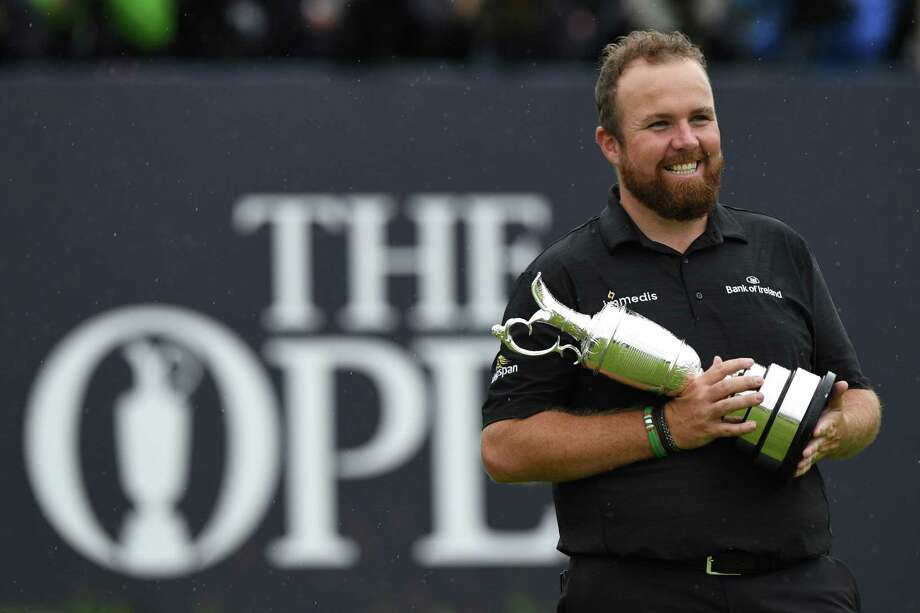 Ireland's Shane Lowry poses with the Claret Jug, the trophy for the Champion golfer of the year after winning the British Open golf Championships at Royal Portrush golf club in Northern Ireland on July 21, 2019. (Photo by Glyn KIRK / AFP) / RESTRICTED TO EDITORIAL USEGLYN KIRK/AFP/Getty Images Photo: GLYN KIRK / AFP or licensors