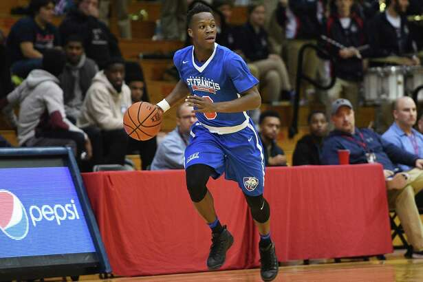 MOON TOWNSHIP, PA - JANUARY 07: Rasheem Dunn #0 of the St. Francis (NY) Terriers brings the ball up court in the first half during the game against the Robert Morris Colonials at the Charles L. Sewall Center on January 7, 2017 in Moon Township, Pennsylvania. (Photo by Justin Berl/Getty Images)
