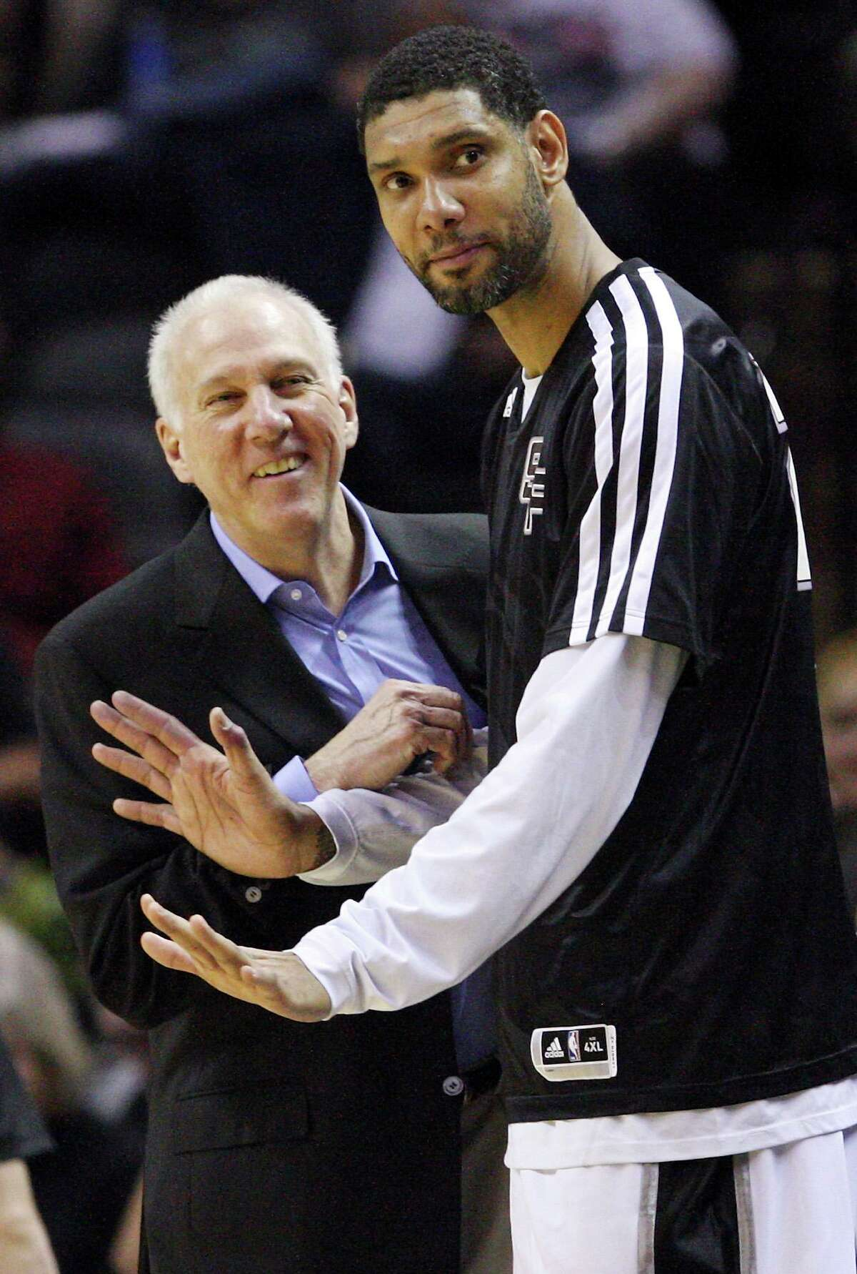 San Antonio Spurs head coach Gregg Popovich and Tim Duncan joke on the bench during second half action against the 76ers Monday March 24, 2014 at the AT&T Center. The Spurs won 113-91.