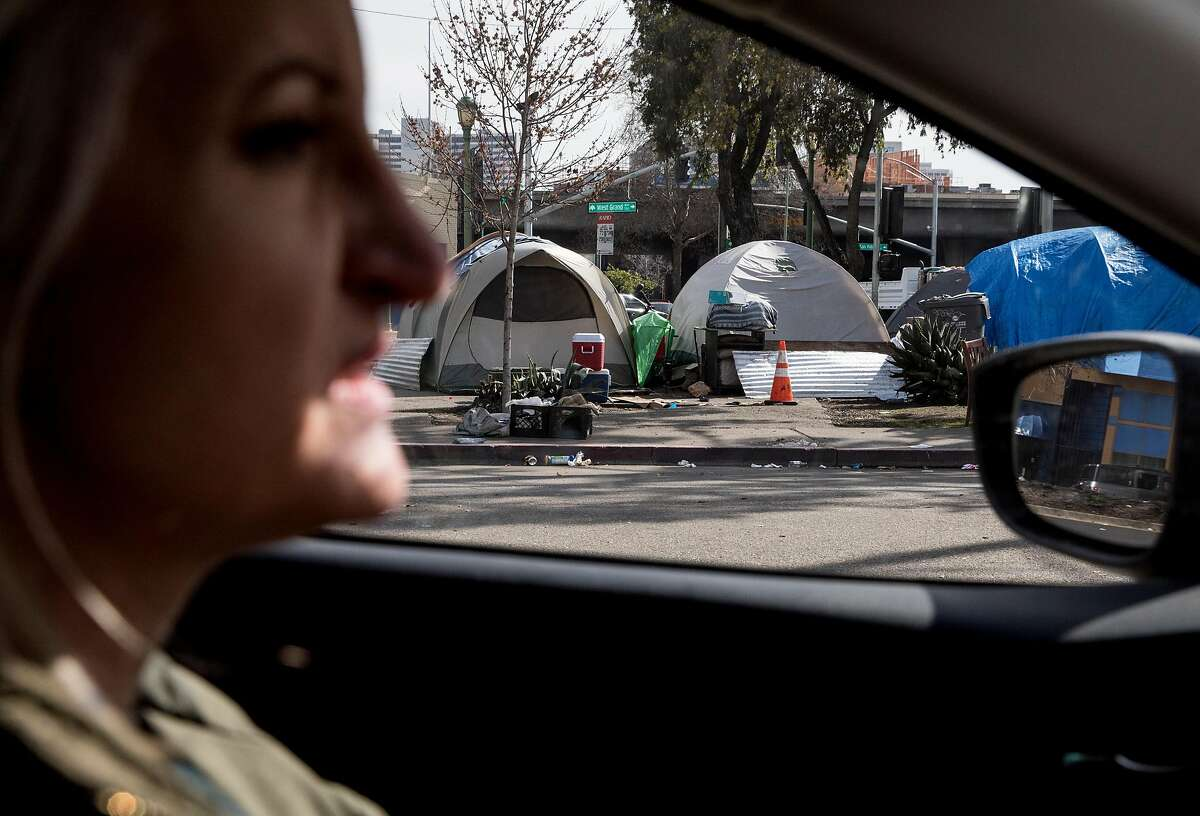 UCSF's HOPE-HOME Project conductor Pamela Olson drives through downtown Oakland looking for missing participants of their study looking into the trends and lives of the older homeless population in the Bay Area in Oakland, Calif. Thursday, Feb. 7, 2019.