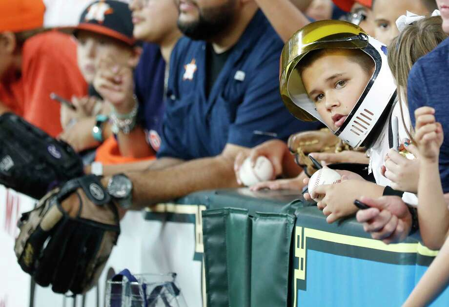 A kid wears an astronaut helmet during batting practice as the Houston Astros will hosted Apollo 11 Night, a special night celebrating the 50th anniversary of the Apollo 11 Mission and the first landing on the moon before the start of an MLB baseball game at Minute Maid Park, Monday, July 22, 2019. Photo: Karen Warren, Staff Photographer / © 2019 Houston Chronicle