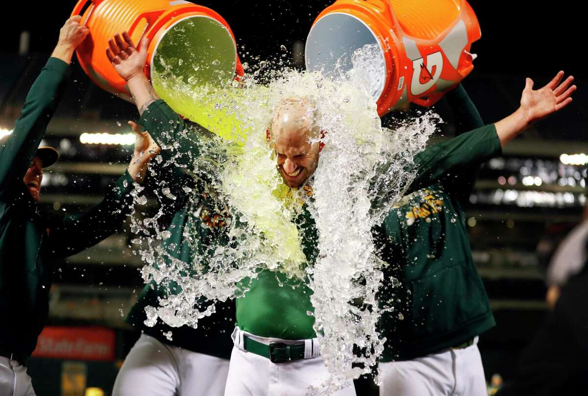 Oakland Athletics' Mike Fiers is doused with Gatorade after throwing no-hitter against Cincinnati Reds during MLB game at Oakland Coliseum in Oakland, Calif., on Tuesday, May 7, 2019.