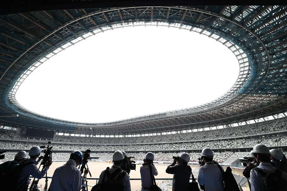 The National Stadium, the centerpiece of the 2020 Tokyo Olympics, will be completed this by the end of the year. Photo: Behrouz Mehri / AFP / Getty Images