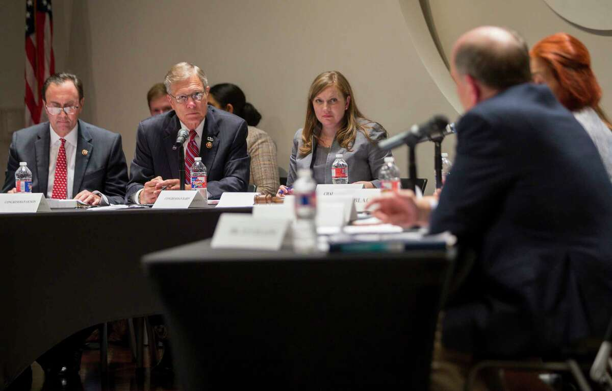 Left to right, U.S. Reps. Pete Olson, R-Sugar Land, Brian Babin, R-Woodville, and Lizzie Fletcher, D-Houston, listen to Louis W. Uccellini, director of the National Weather Service, provide testimony at a House environment subcommittee field hearing at Houston Community College in Houston, Monday, July 22, 2019.