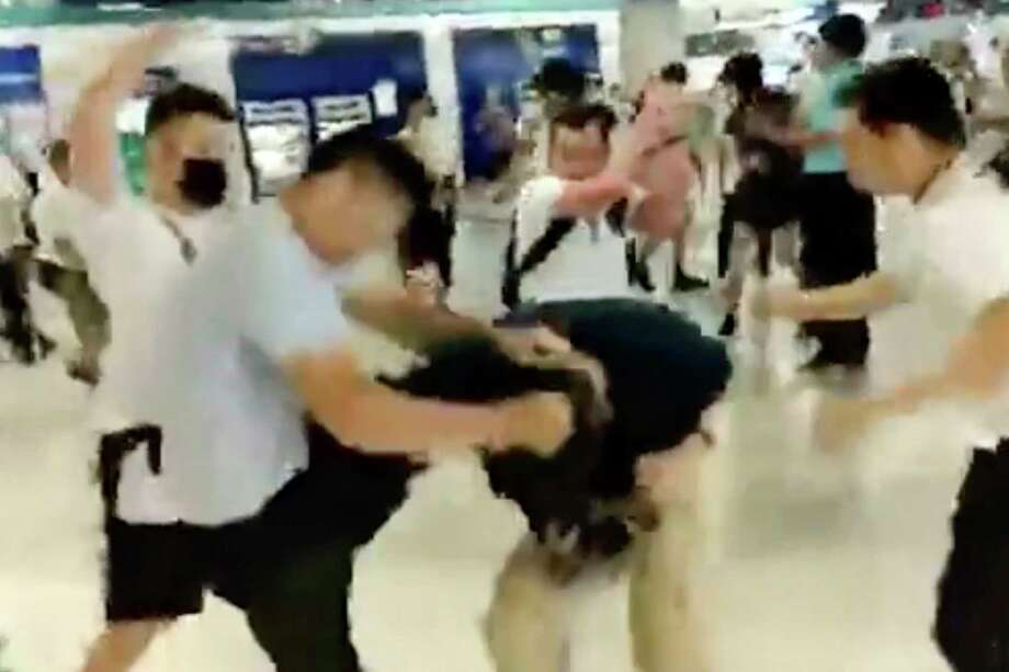 In this image taken from a video footage run by The Stand News via AP Video, white shirted men attacked a man dressed in black shirt at a subway station in Hong Kong on Sunday, July 21, 2019.  China doesn't want to intervene in Hong Kong's protests but that doesn't mean it won't, as a thuggish attack on the protesters brought accusations of connivance between police and criminal gangs. (The Stand News via AP Video) HONG KONG OUT Photo: Anonymous / CCTV