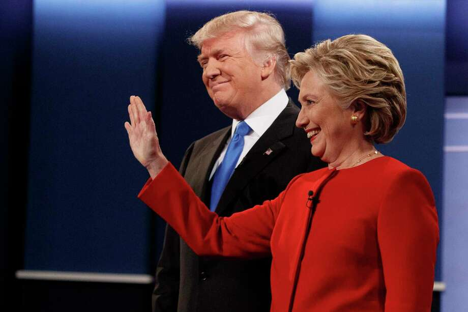Donald Trump and Hillary Clinton prepare to debate in 2016. A reader wonders why Clinton has not returned to fight in the 2020 presidential election. Photo: Associated Press File Photo / Copyright 2016 The Associated Press. All rights reserved.