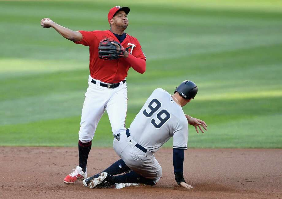 MINNEAPOLIS, MN - JULY 22: Aaron Judge #99 of the New York Yankees is out at second base as Jonathan Schoop #16 of the Minnesota Twins turns a triple play during the first inning of the game on July 22, 2019 at Target Field in Minneapolis, Minnesota. (Photo by Hannah Foslien/Getty Images) Photo: Hannah Foslien / 2019 Getty Images