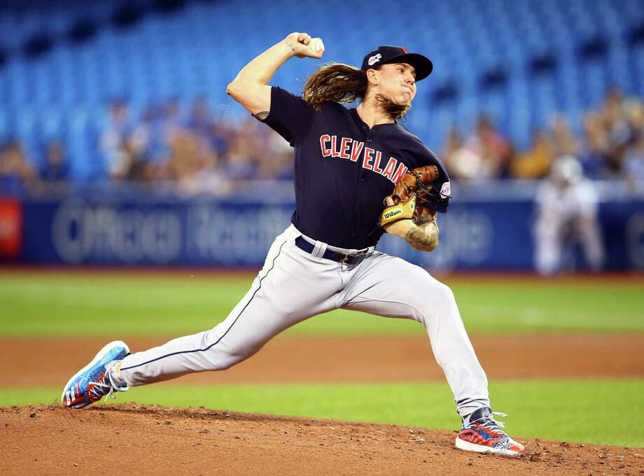 TORONTO, ON - JULY 22:  Mike Clevinger #52 of the Cleveland Indians delivers a pitch in the first inning during a MLB game against the Toronto Blue Jays at Rogers Centre on July 22, 2019 in Toronto, Canada.  (Photo by Vaughn Ridley/Getty Images) Photo: Vaughn Ridley / 2019 Getty Images