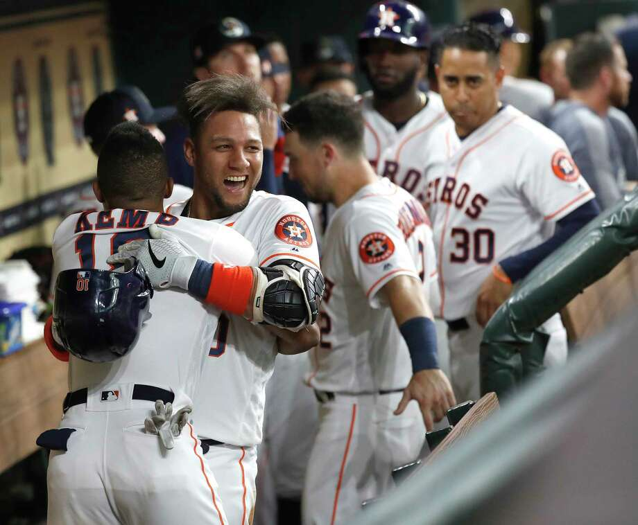 Houston Astros Yuli Gurriel (10) is hugged by Tony Kemp (18) in the dugout as they celebrated his two-run home run during the third inning of an MLB baseball game at Minute Maid Park, Monday, July 22, 2019. Photo: Karen Warren, Staff Photographer / © 2019 Houston Chronicle