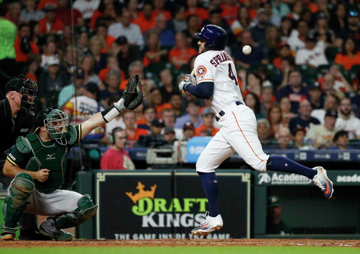 Houston Astros George Springer (4) gets hit by a pitch from Oakland Athletics Wei-Chung Wang during the sixth inning of an MLB baseball game at Minute Maid Park, Monday, July 22, 2019.