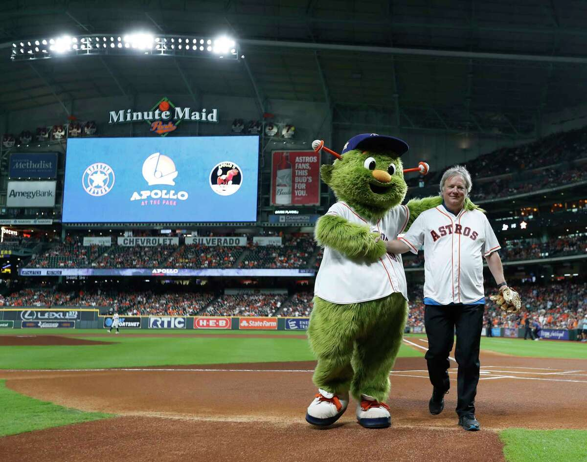 Rick Armstrong, son of Neil Armstrong walks back from throwing out the ceremonial first pitch with Orbit before the start of the first inning of an MLB baseball game at Minute Maid Park, Monday, July 22, 2019, as the Houston Astros hosted Apollo 11 Night, a special night celebrating the 50th anniversary of the Apollo 11 Mission.