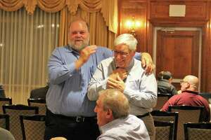 Councilman Doug Hempstead and Town Clerk Richard McQuaid share a moment at the Republican Town Committee nominating convention on Monday, July 22, 2019.