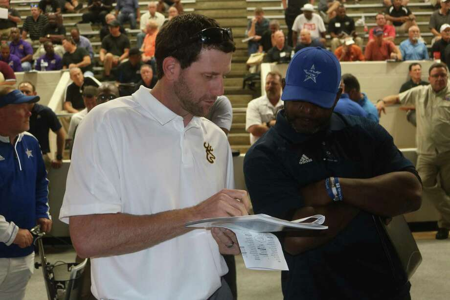 Deer Park head football coach Austin Flynn confers with a Baytown Sterling coach at the recent Referee Selection meeting. The annual preseason prediction by Dave Campbell's magazine believes both schools will miss the playoffs. Photo: Robert Avery