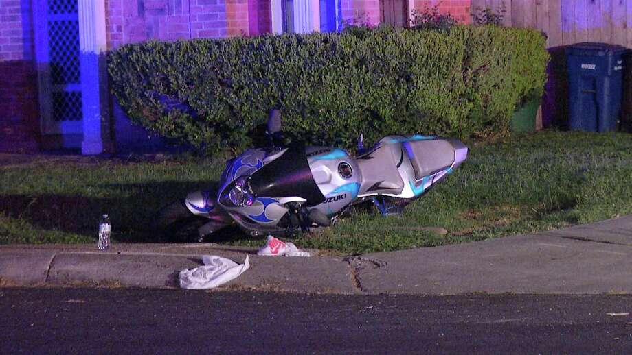 A man and a woman riding a motorcycle were taken to an area hospital after a station wagon crashed into them on the city's Northeast Side.  Photo: Ken Branca