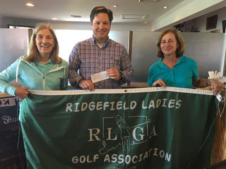 From left to right: Tony Phillips from the Ridgefield Emergency Fund and golf tournament chairs, Chris Frazee and Bonnie Harrington. Photo: Contributed Photo
