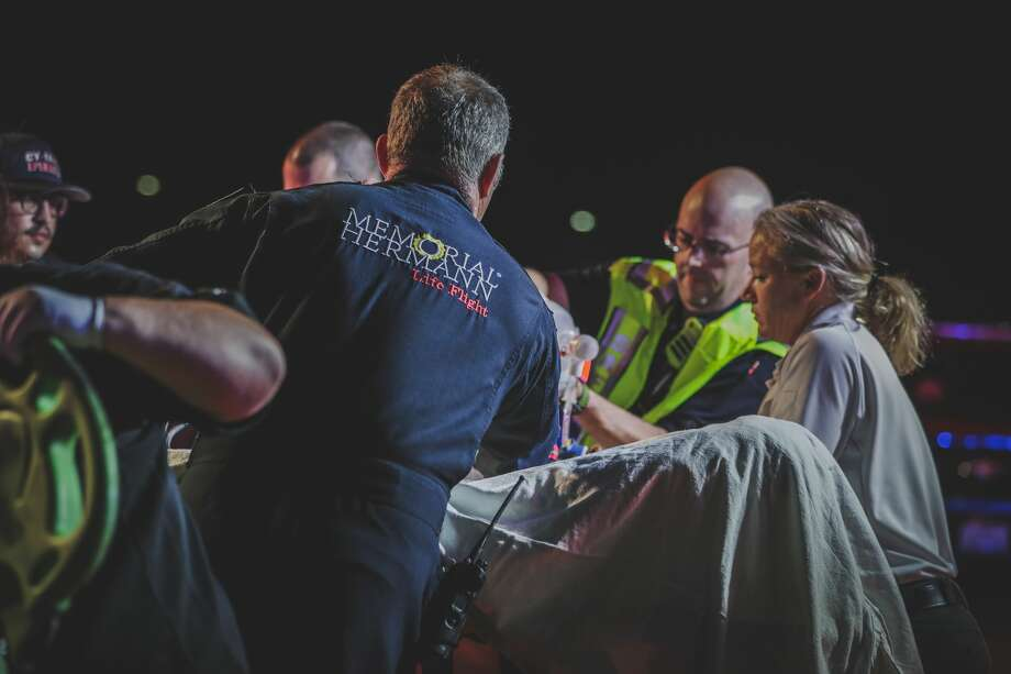 Paramedics with Cy-Fair Volunteer Fire Department and Memorial Hermann Life Flight tend to a young man found shot in the head along Fry Road on Monday, July 22, 2019. Photo: Lt. Daniel Arizpe, PIO/ Cy-Fair Fire Dept