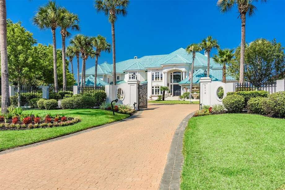 This property was designed by and for renowned romance novelist Judith McNaught. At $5.3 million, it's the priciest listing in League City. Photo: Phyllis Foster Real Estate