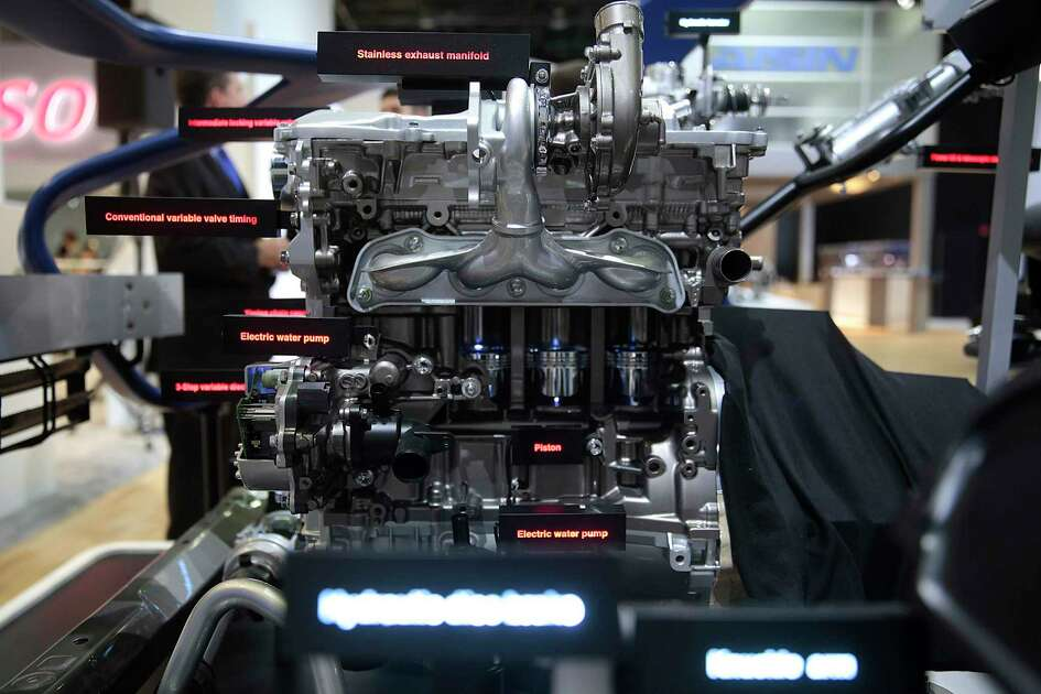 An Aisin motor is displayed during the 2014 North American International Auto Show in Detroit. AW Texas Inc., owned by Aisin, a Fortune Global 500 company, announced it is building a facility in Cibolo.