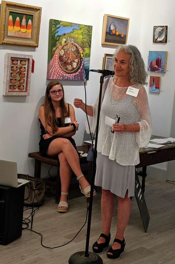 "Drew Lamm 1st Place Winner reading ""Cheese and Scallion Scone"" (poem). Photo: Rowayton Arts Center / Contributed Photo"