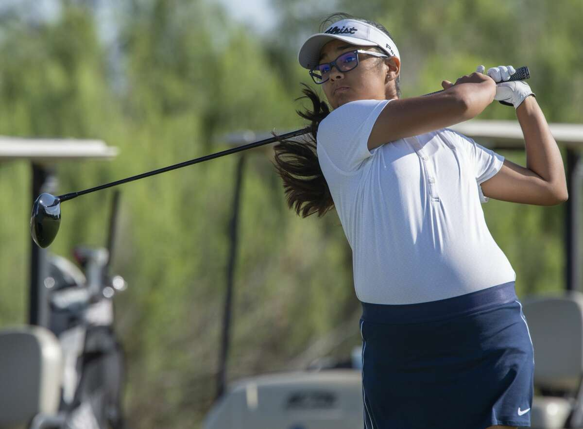 Anaya Perales follows her shot 07/23/19 in the first round of the Women's City Golf Tournament at Hogan Park Golf Course. Tim Fischer/Reporter-Telegram