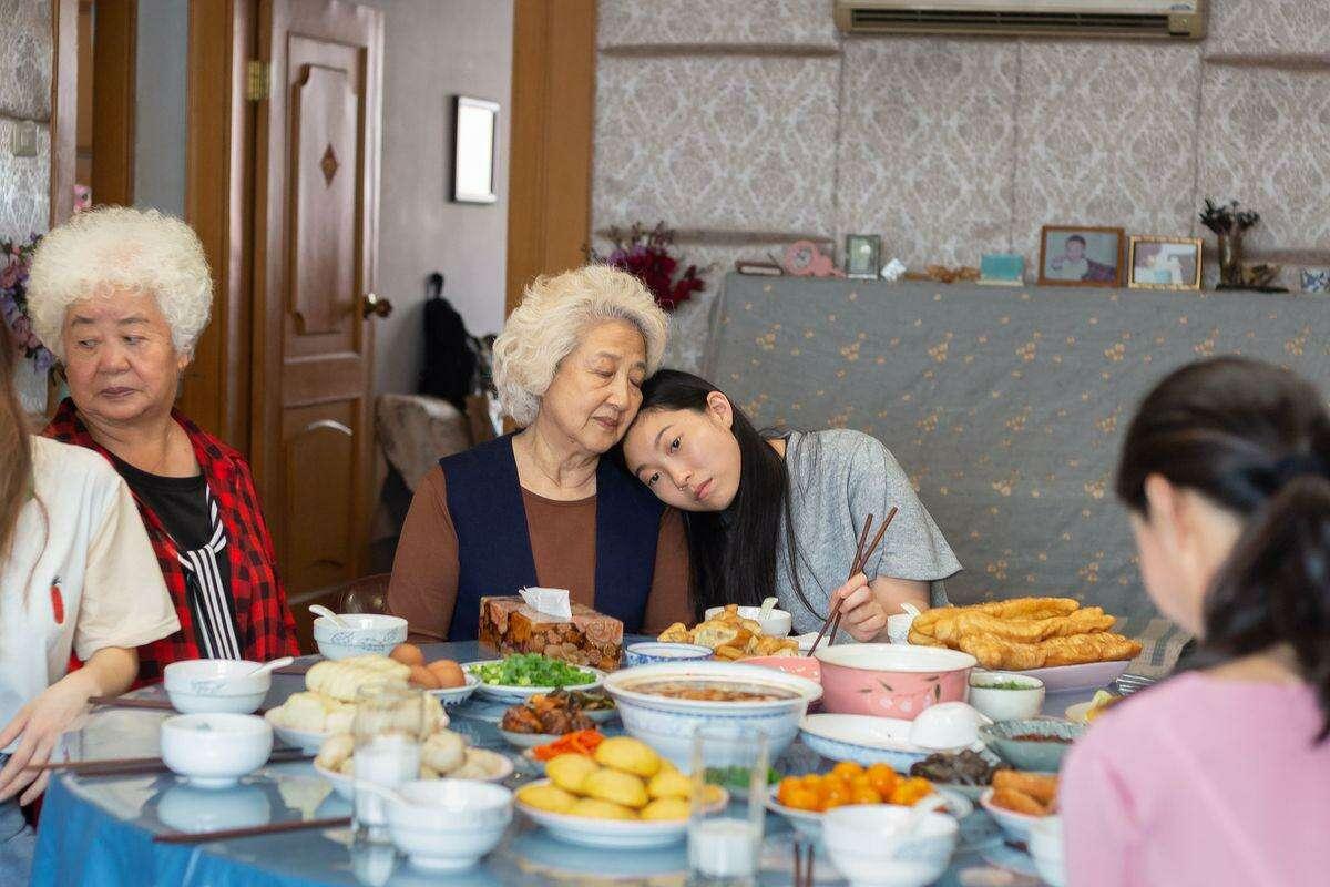 Shuzhen Zhao and Awkwafina, center, in