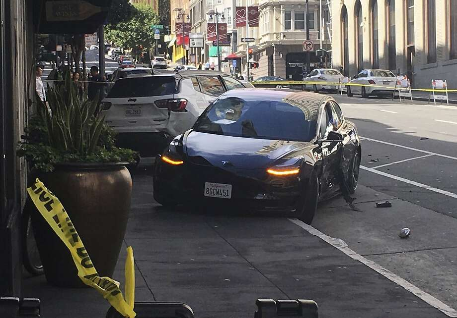 This photo taken Sunday, July 21, 2019, and provided by KGO-TV shows the scene after a woman was arrested after running a red light in a rented Tesla in San Francisco and causing a crash that killed a tourist and left his wife critically injured. Officers were investigating whether the Tesla, which was rented through the peer-to-peer car rental service Get Around, was operating on self-driving mode, police said in a statement Monday, July 22, 2019. (Kate Larsen/KGO-TV via AP) Photo: Kate Larsen, Associated Press