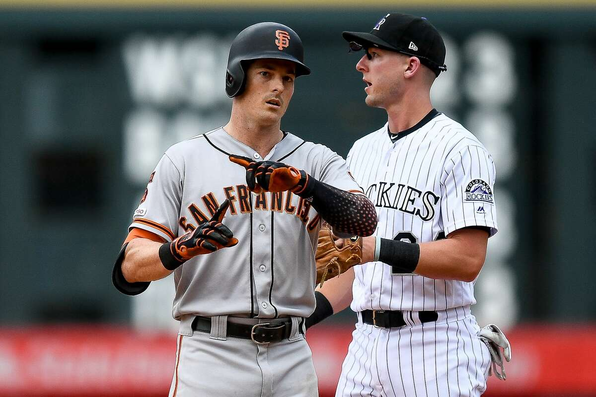 Mike Yastrzemski of the San Francisco Giants celebrates after reaching second base on a fifth inning double against the Colorado Rockies at Coors Field on July 17, 2019 in Denver.