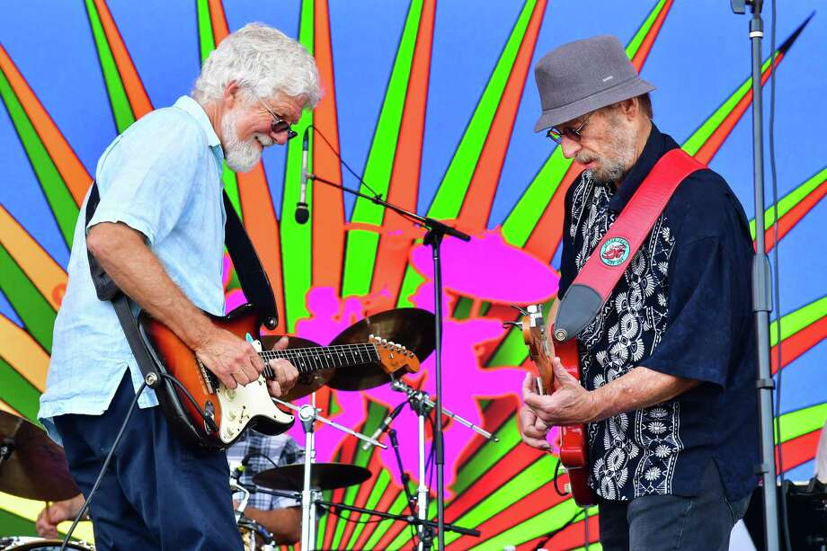 Fred Tackett, left, and Paul Barrere of Little Feat perform during the 2019 New Orleans Jazz & Heritage Festival in May. The group, which is marking its 50th anniversary this year, will be performing at The Capitol Theatre in Port Chester, N.Y., on Oct. 18. Photo: Erika Goldring / Getty Images / 2019 Erika Goldring