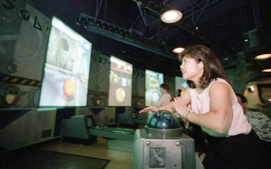 June 12, 2000: A guest enjoys the popular HyperBowl center in the Airtight Garage at the Sony Metreon. Photo: Thor Swift / The Chronicle