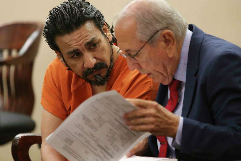 Paulo Gonzalez Chavez talks with his attorney, Charles Mais, Jr., after his sentencing hearing in the Bexar County 226th State District Court, Tuesday, July 23, 2019. He pled no contest in the murder of his girlfriend, Idalia Ceredon Becerra, 29, in December of 2017. Meza was received a 35-year sentence and was ordered to pay $6,000 in restitution for Becerra's funeral expenses. Photo: Jerry Lara, Staff / Staff Photographer / © 2019 San Antonio Express-News