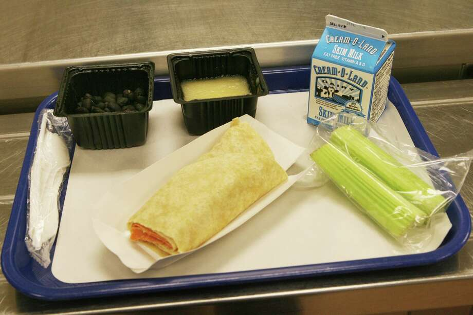 An italian wrap, applesauce, balck beans, celery, and milk are on the menu on the first day of the lunch program at Cesar Batalla School in Bridgeport, Conn. on Monday, July 2, 2012. Photo: B.K. Angeletti / B.K. Angeletti / Connecticut Post