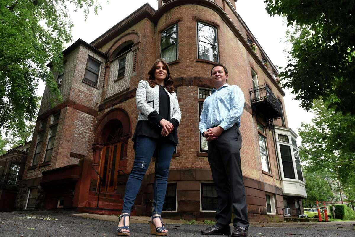 Click through the slideshow to see the 19 apartment buildings that Redburn Development is buying in Schenectady's Stockade neighborhood. Elizabeth Young Jojo, vice president of Redburn Development, left, James Quinn, regional property manager, right, are pictured outside a Redburn apartment building at 11 North Church Street on Tuesday, July 23, 2019, in Schenectady, N.Y. The company recently purchased 19 properties in Schenectady's historic Stockade district. (Will Waldron/Times Union)