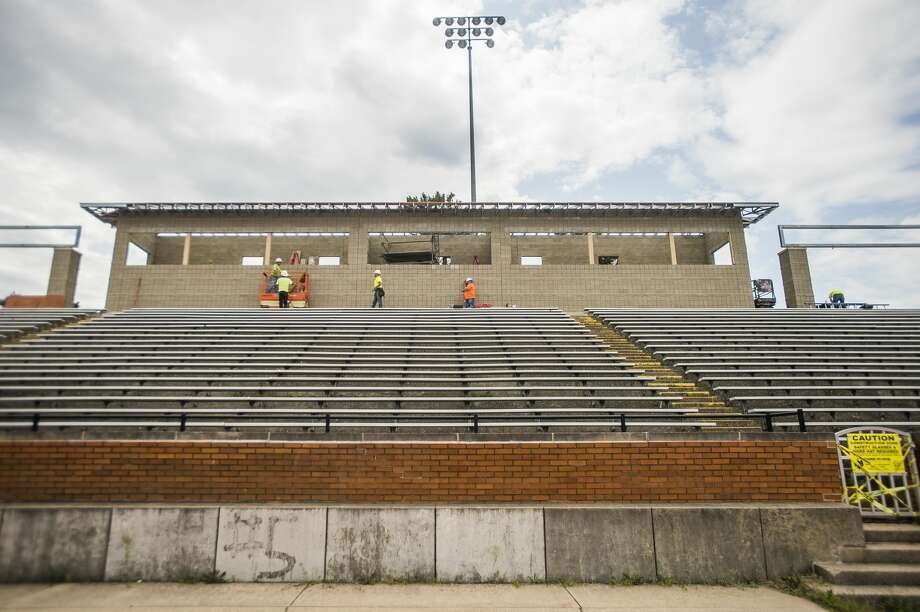 Construction workers with Three Rivers Corporation work on the new press box at Midland Community Stadium on Tuesday, July 23, 2019. (Katy Kildee/kkildee@mdn.net) Photo: (Katy Kildee/kkildee@mdn.net)