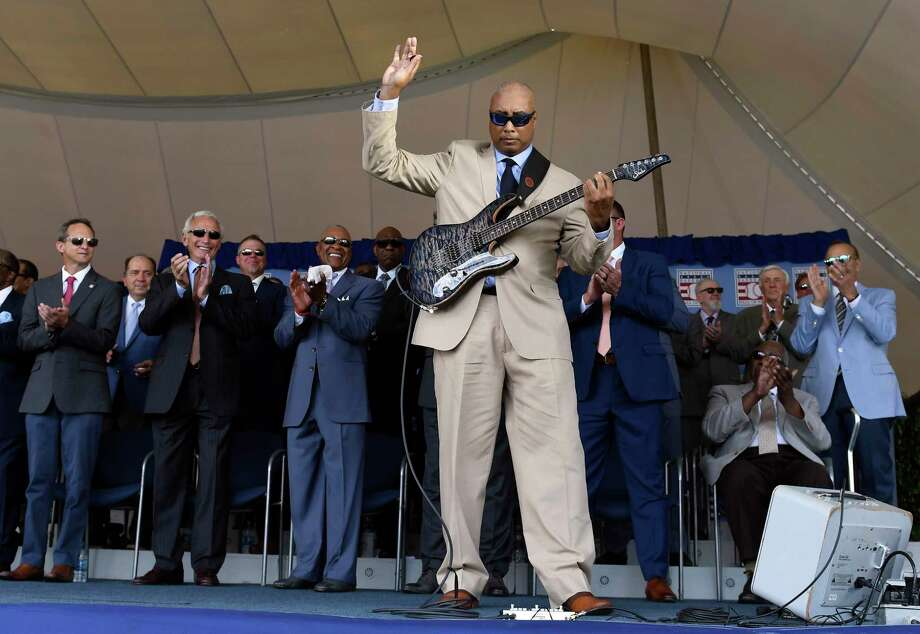 Former New York Yankees player Bernie Williams, foreground, performs during a National Baseball Hall of Fame induction ceremony at the Clark Sports Center, Sunday, July 21, 2019, in Cooperstown, N.Y. (AP Photo/Hans Pennink) Photo: Hans Pennink / Associated Press / Copyright 2019 The Associated Press. All rights reserved.