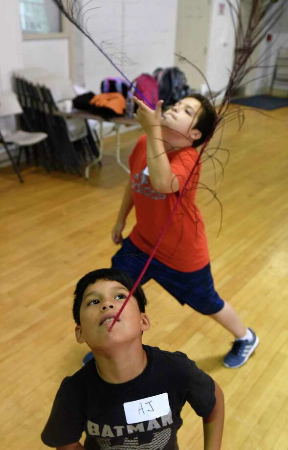 A.J. Alvarez, 9, of Port Chester, N.Y., balances a feather on his chin during the Palace Theatre Circus Camp at the Boys & Girls Club in Greenwich, Conn. Tuesday, July 23, 2019. The four-day camp teaches fourth- and fifth-graders a variety of circus feats, including juggling, clowning, acrobatics, miming, plate-spinning and more. The camp will also be held at the Palace Theatre in Stamford next week. Photo: Tyler Sizemore / Hearst Connecticut Media / Greenwich Time
