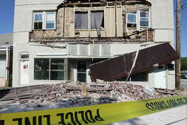 The front wall of an older Wood River building in the 100 block of Whitelaw Avenue collapsed Monday for reasons as yet unknown. Whitelaw Avenue is closed to traffic in that block while officials look for a cause.