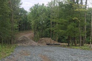 The site off North Road in North Greenbush as seen in July 2019 where town building coordinator was intending to have 12 houses built. In June 2019, he sold more than 50 acres to a limited liability company in part controlled by controversial local developer David Mulinio.