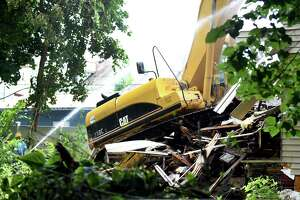 A blighted city-owned property that neighbors complained to the city about for years is torn down at 792 Francis Ave. in Mont Pleasant on Tuesday, July 23, 2019, in Schenectady, N.Y. (Catherine Rafferty/Times Union)