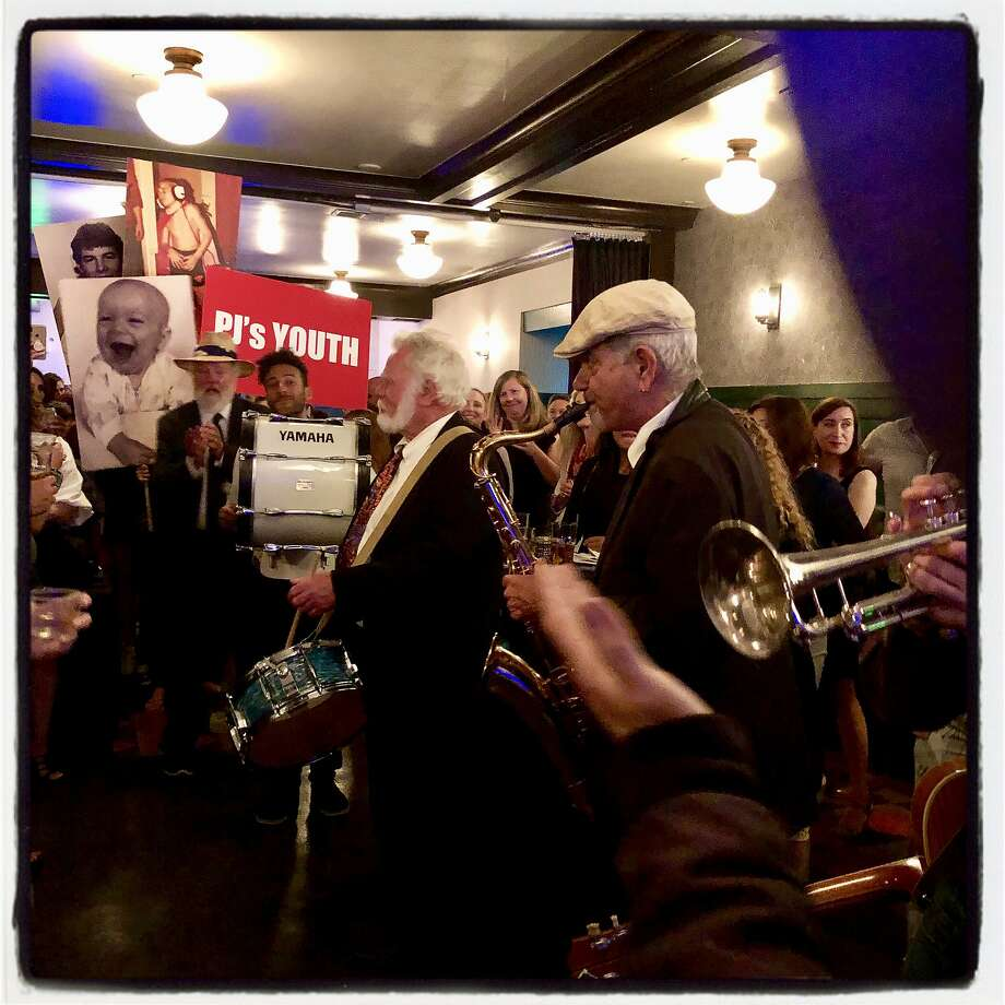 The North Beach Brass Band celebrates the 50th birthday of PJ Johnston. July 6, 2019. Photo: Catherine Bigelow / Special To The Chronicle
