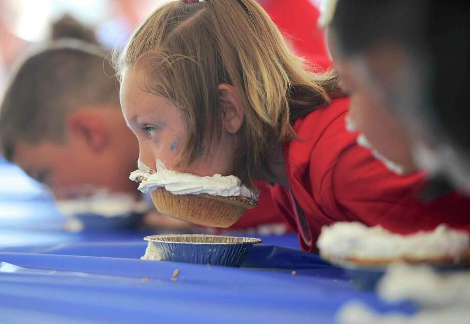 A pie-eating contest is among the offerings planned at the two-day fair sponsored by the Greater New Milford Chamber of Commerce. Photo: H John Voorhees III / Hearst Connecticut Media / The News-Times