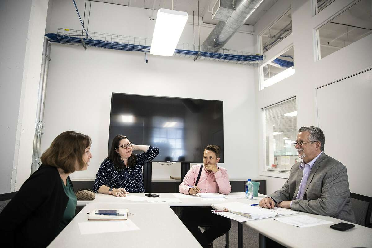 Mission St between 9th & 10th St, 4:46PM: Jeff Kositsky, director of San Francisco Department of Homelessness and Supportive Housing, right, conducts a meeting with the Healthy Street Operations Center (HSOC) team in San Francisco, Calif. on Tuesday, June 18, 2019.