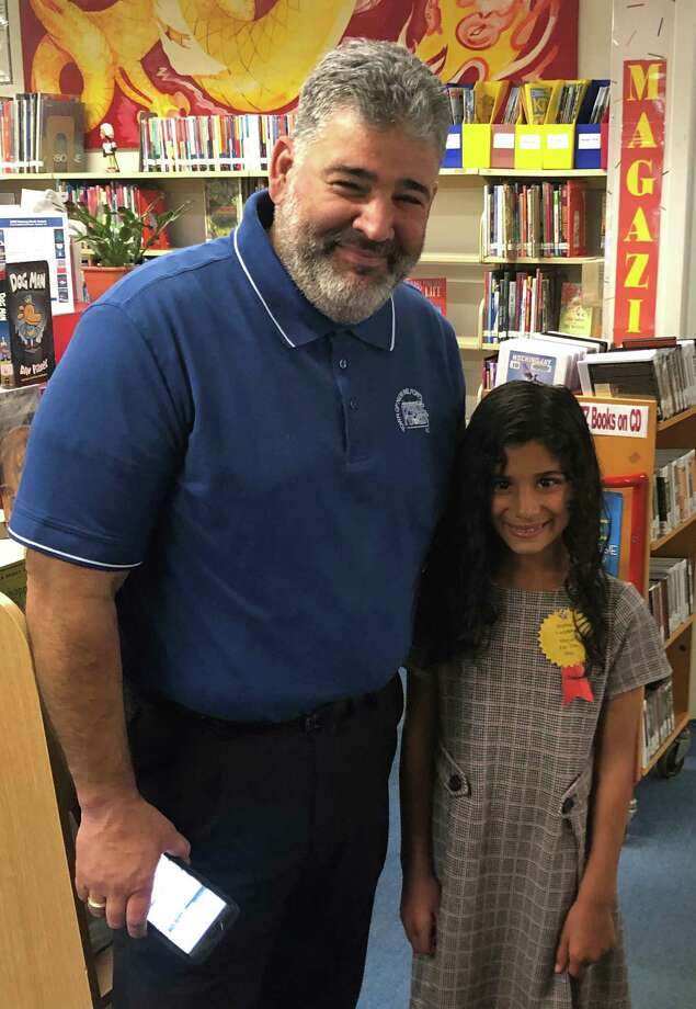 """New Milford Mayor Pete Bass recently spent a day with 8-year-old Sophia Varghese, who held the title of """"Mayor for the Day."""" Sophia won the honor of assuming the title through a PTO raffle at Northville Elementary School. The mayor, Sophia and Sophia's mother, Cara, toured the town, first visiting all the department heads at the Roger Sherman Town Hall. That was followed by a trip to the library to meet its director, Sally Tornow, and other staff, and the senior center. Photo: Deborah Rose / Hearst Connecticut Media / The News-Times  / Spectrum"""