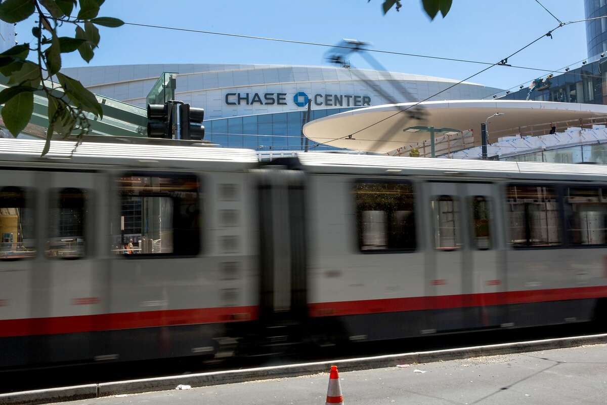 A Muni train T-line passes by a soon functioning Muni stop outside the Chase Center. Any ticket to Chase Center Warriors games, concerts, or any other events will automatically include a ticket to ride on Muni at no additional cost. On Tuesday, July 23, 2019. San Francisco, Calif.